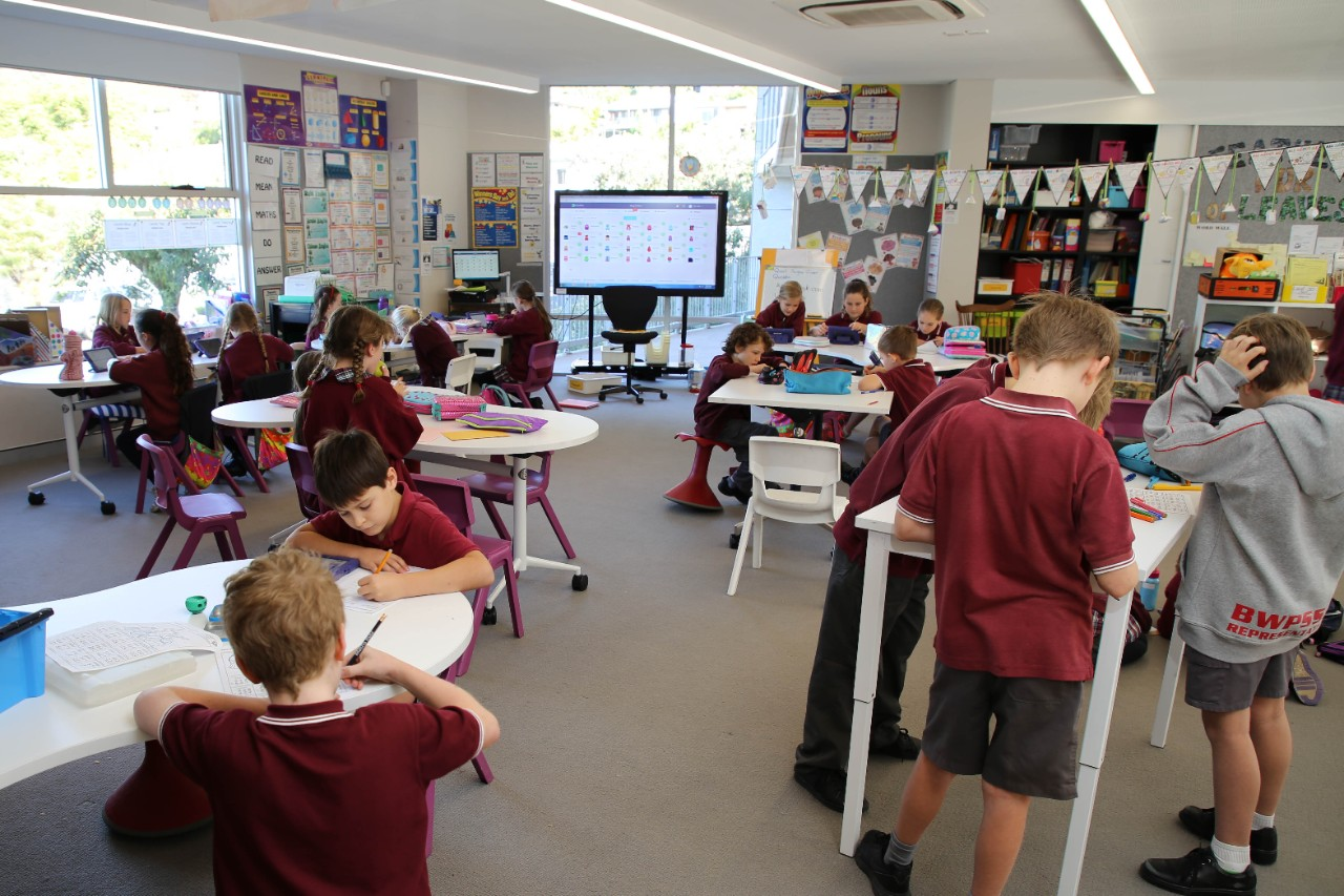 Stage 2 students participating in maths activities at their desks